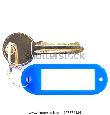 Key with a blank tag, isolate on white background. Add your text on the tag.