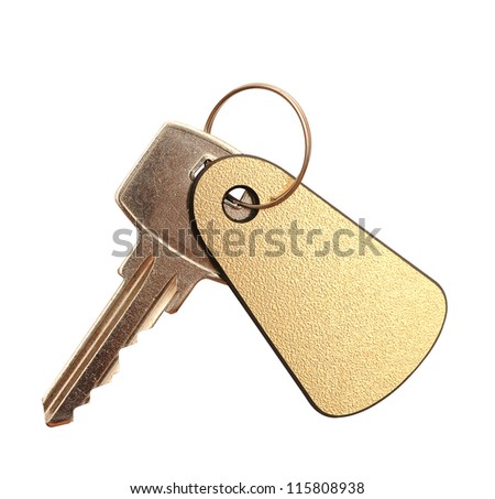 Key with blank golden label  for your text isolated on white background