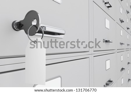 Key with blank tag in a deposit box - stock photo