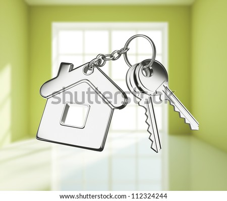 key with key chain on green rooms - stock photo