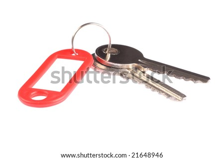Key with red label isolated on white background