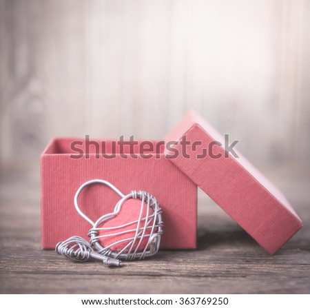 Key with the heart and open gift box as a symbol of love,valentin background,love concept - stock photo
