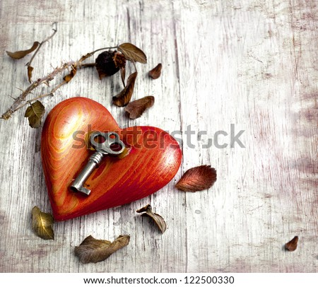 Key with the heart as a symbol of love/vintage card with red heart on grunge old background/valentin es day background - stock photo