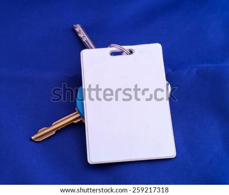 key with white key card - stock photo