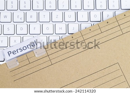 Keyboard and folder personal - stock photo