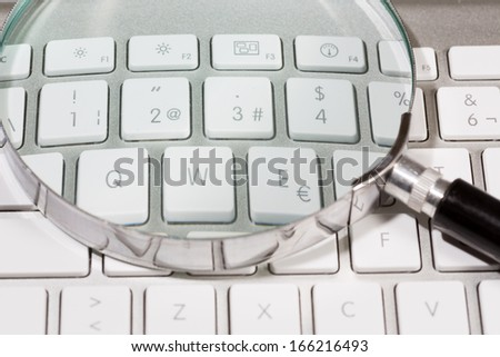 Keyboard and magnifying glass to search the internet
