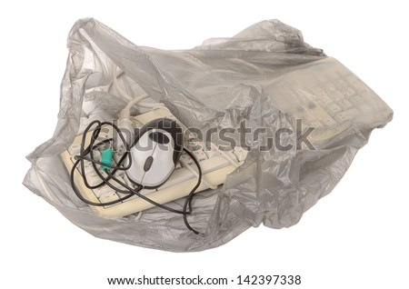 Keyboard and mouse in a garbage bag - stock photo