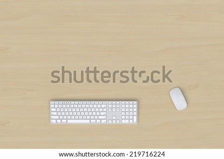 keyboard and mouse over wooden table - stock photo