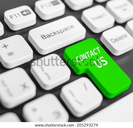 Keyboard button Contact us colored in green - stock photo