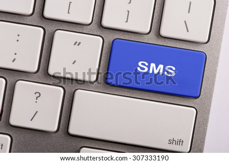 keyboard button with word SMS