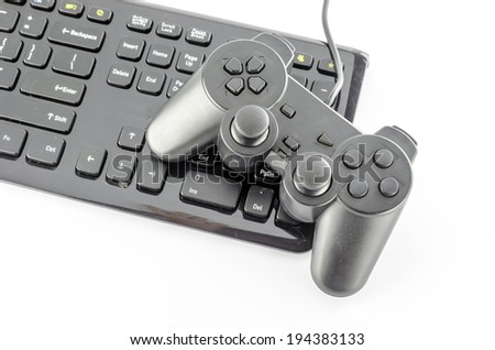 keyboard computer and game controller on a white background