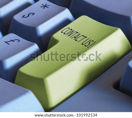 Keyboard enter key with special word- contact us - stock photo