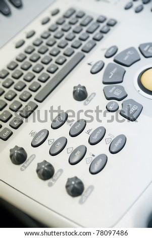 keyboard modern medical ultrasound device as a background - stock photo