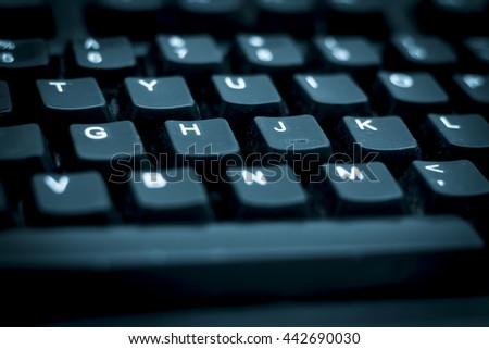 Keyboard of a desk top computer, isolated, selective focus, shallow depth of field, concept of work & technology. - stock photo