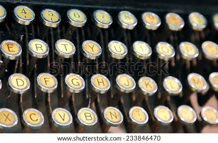 keyboard of an old typewriter used in the 40s - stock photo