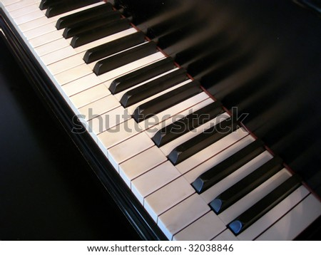 Keyboard of old grand piano - stock photo