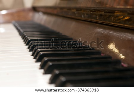 Keyboard of piano. Selective focus image. Warm color toned music background - stock photo
