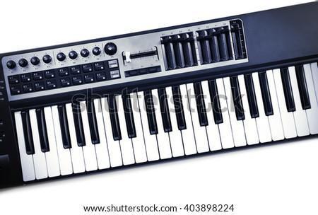 Keyboard of synthesizer closeup - stock photo
