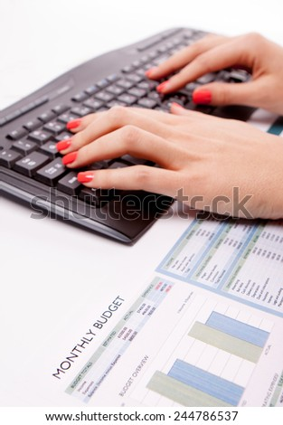 Keyboard on office desk used by a businesswoman.