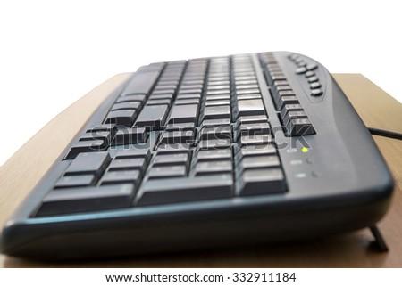 Keyboard on wooden - stock photo