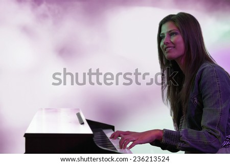 Keyboard Player on Stage - stock photo