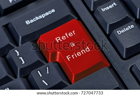 Keyboard red button with refer a friend text