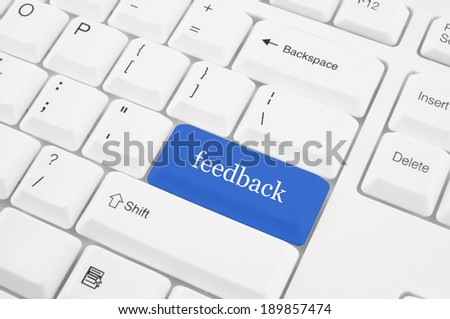 Keyboard with blue feedback button - stock photo