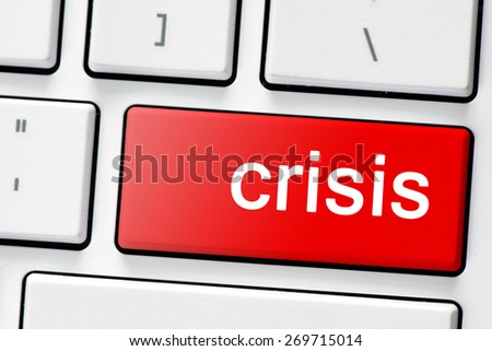 Keyboard with button crisis. Computer white keyboard with red button crisis - stock photo