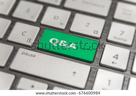 Keyboard with green key Enter and word Q&A  button modern pc text communication board