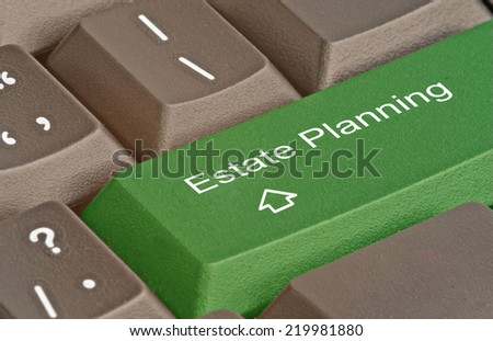 Keyboard with hot key for estate planning - stock photo