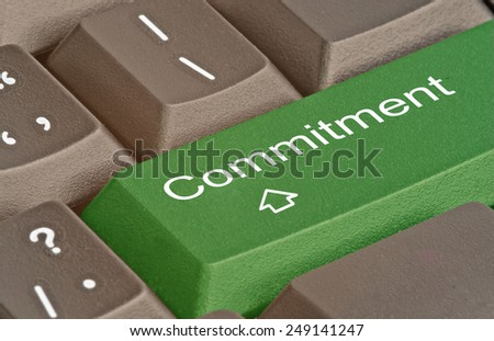 keyboard with key for commitment