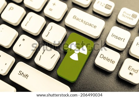 Keyboard with radioactive green button. Concept image. - stock photo