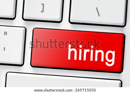 Keyboard with red button hiring. Computer white keyboard with red button hiring - stock photo