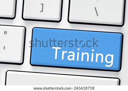 Keyboard with training button. Computer white keyboard with training button - stock photo