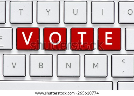 Keyboard with vote button. Computer white keyboard with vote button - stock photo