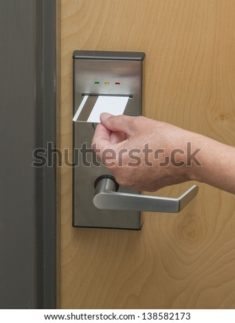 Keycard being inserted in electronic lock