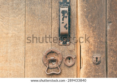 Keyhole door knocker and handle in weathered wooden door - stock photo & Stock Images similar to ID 35443582 - door handle and keyhole on ... pezcame.com
