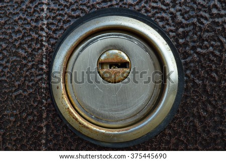 Keyhole in the iron door. Parts and elements of the door. - stock photo