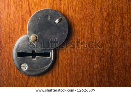 keyhole in wooden door with copy space