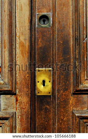 Keyhole of an old house wooden front door. close up copy space. concept photo of home invasion, home security, crime, insurance,safety, privacy, private  - stock photo
