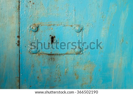 keyhole on metal doors painted in blue - stock photo