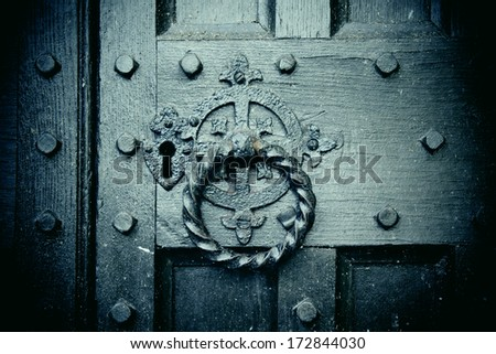 Keyhole on wooden door - stock photo