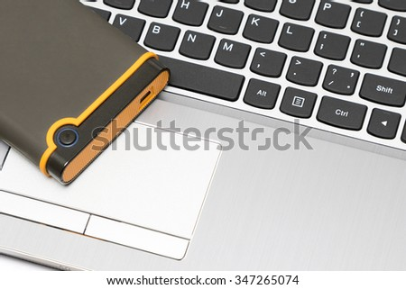 Keypad of a notebook and usb hard drive. Fragment of the keypad of the modern notebook and usb hard drive. - stock photo
