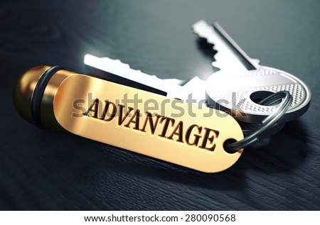 Keys and Golden Keyring with the Word Advantage over Black Wooden Table with Blur Effect. Toned Image. - stock photo
