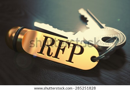 Keys and Golden Keyring with the Word RFP - Request for Proposal - over Black Wooden Table with Blur Effect. Toned Image. - stock photo