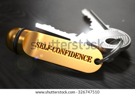 Keys and Golden Keyring with the Word Self-Confidence over Black Wooden Table with Blur Effect. - stock photo