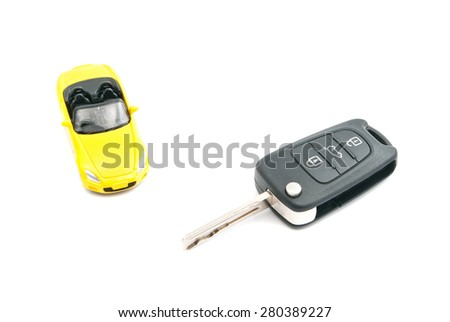 keys and yellow sport car on white background closeup