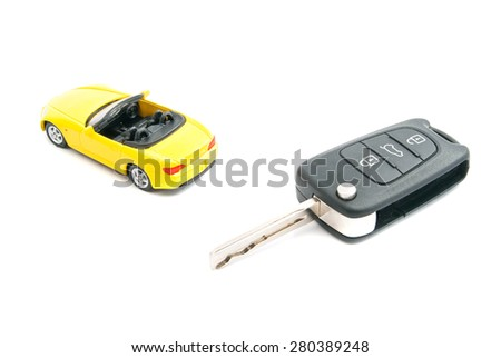 keys and yellow sport car on white closeup - stock photo