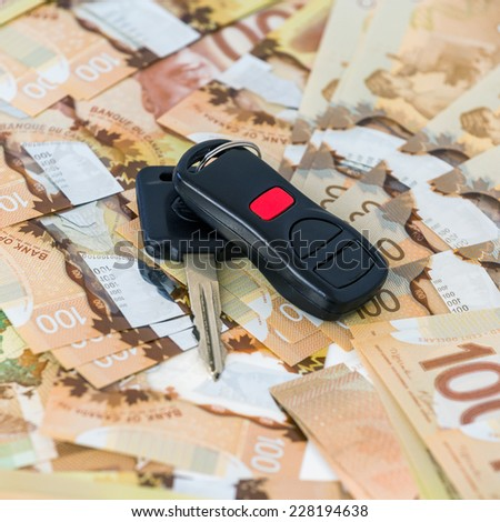 Keys from car on banknotes - stock photo