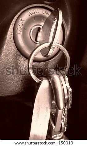 keys in ignition, sepia - stock photo